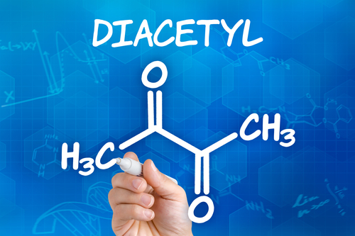 Hand with pen drawing the chemical formula of Diacetyl